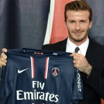 British football player David Beckham poses presenting his new jersey after a press conference on January 31, 2013 at the Parc des Princes stadium in Paris. Beckham signed a five-month deal with the French Ligue 1 football club Paris Saint Germain until the end of June.      AFP PHOTO / FRANCK FIFE